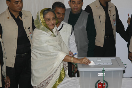 This image has an empty alt attribute; its file name is Hasina-casting-ballot.jpg